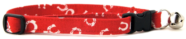 Tiny horseshoes tossed on red Cat Collar